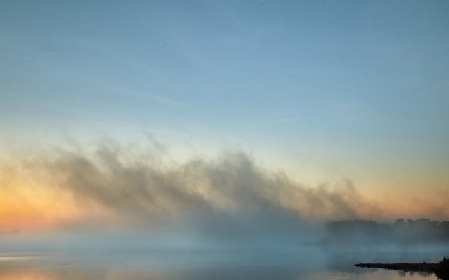 Photograph of the morning fog lifting from Chief White Crane near Yankton South Dakota by Sioux Falls based landscape photographer Paul Heckel.